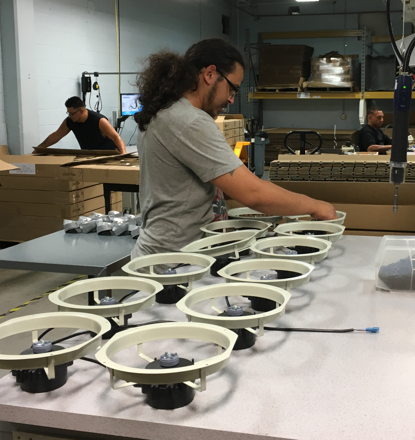 Employee Assembling EC Motor with Fan Ring and Blade