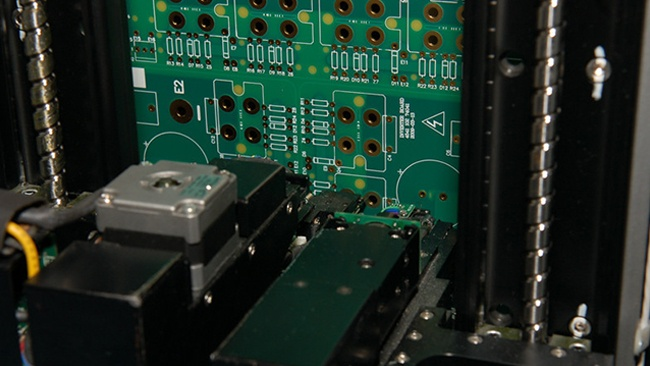 Flying Probe Electrically Testing a Circuit Board