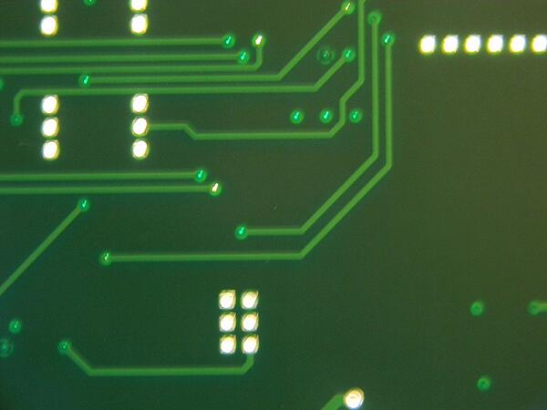 Tenting Vias of a Printed Circuit Board Under a Microscope