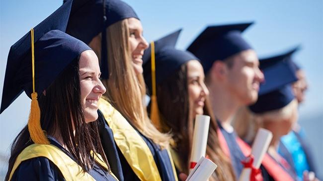 Young Graduates Celebrating on Graduation Day