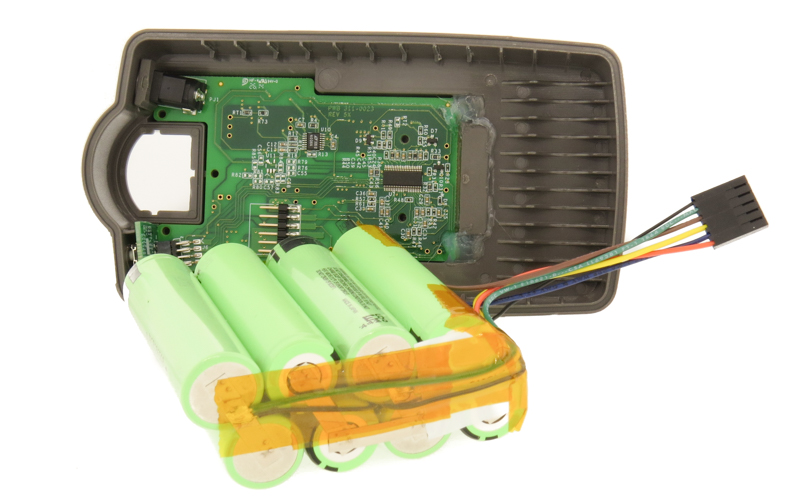 Example of battery pack enclosure, BMS, cells and harness during assembly process.