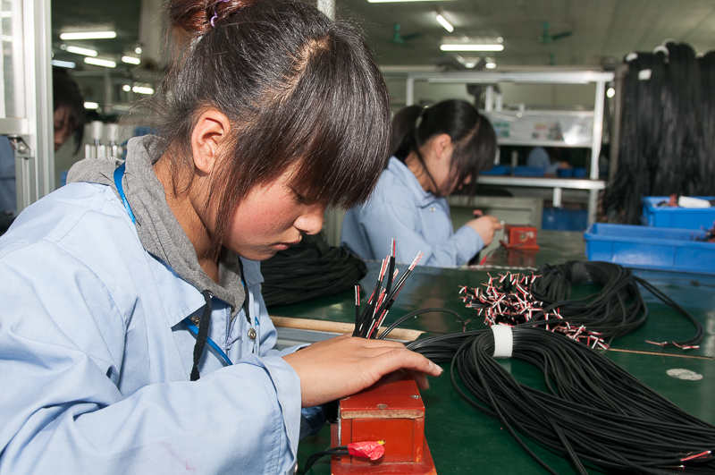 Cable assemblies being manufactured in China.