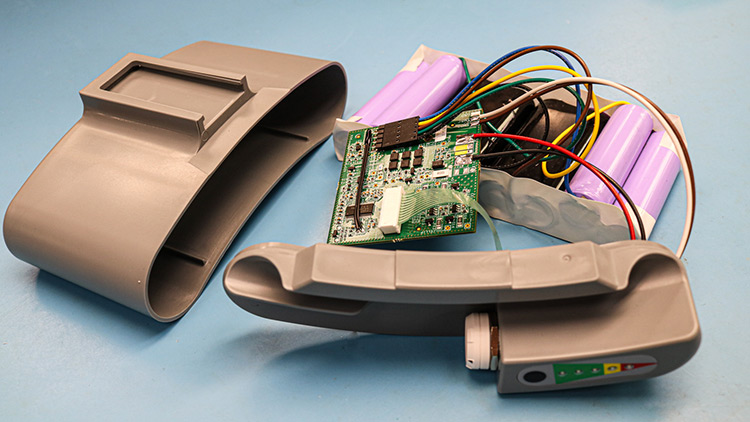 Custom manufactured battery pack for a medical device with various components