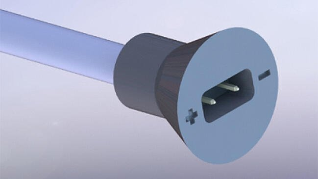 3D model of a custom cable connector with polarity markings.