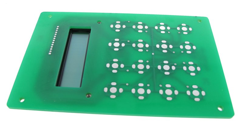 Dome switch pads on a PCB.