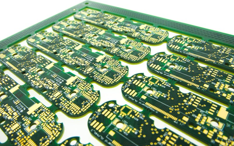 PCBs with rounded routing features