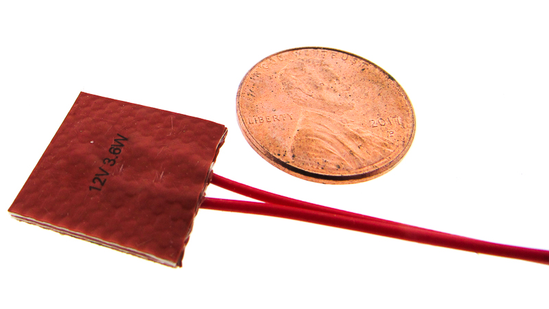 Example of a small flexible heater the size of a penny.