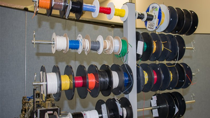 Spools of cable and wire used in cable assembly manufacturing