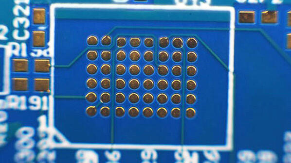 Printed circuit board with via in pad
