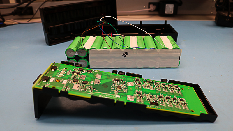 Inside of custom battery pack showing electronics, components, and materials.