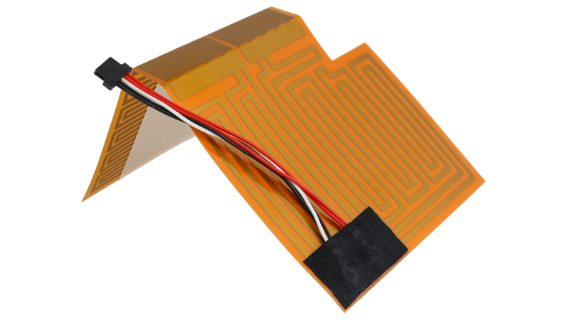 Flexible polyimide heater with surface-mounted thermistor